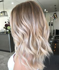Cool ash blonde Balayage colour long hair Textured curls