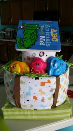 Noahs Ark diaper cake..... contains 2 bottles, 4 receiving blankets, 1 puzzle toy with animal pieces, 1 dishwasher basket, 1 book, ribbon, 42 size 2 diapers, and 1 travel wipes
