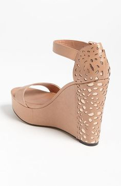 Vince Camuto 'Sakina' Sandal  $128.95  Pebbled cut-outs accent the back of a towering wedge simplified by a modest upper and finished with a chic, adjustable ankle strap.