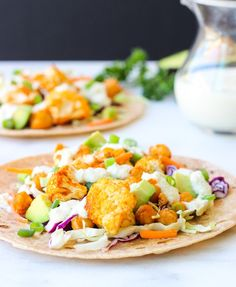 Buffalo Cauliflower and Chickpea Tacos- an easy and healthy option to spice up the meal plan! #glutenfree #meatlessmonday