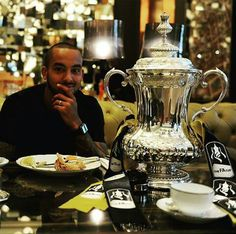 Theo Walcott with The FA Cup (May 2015)