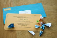 Tiny paper airplanes as confetti in the invitations