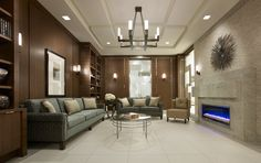 Peaceful fireplace lounge at Parc Nuvo condo community in Toronto.
