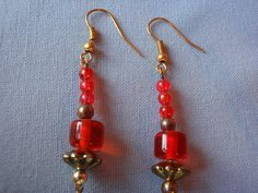 Brincos contas vidro vermelhas by ACBeads, via Flickr