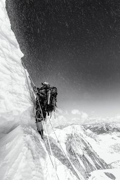 Flying Ice - On the Serac Wall at 6,800m on Cho Oyu | The black & white version seemed to portray the atmosphere far better than the colour version as the ice from the climber above Tshiring, rains down on him.
