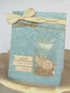 what a great idea!!!...clear card stock die cut for jar, sewed onto card...filled with real sand...
