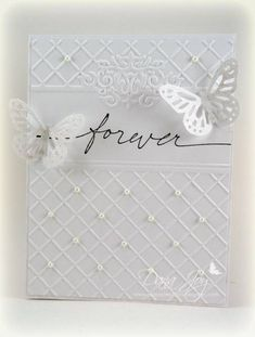 pretty white on white wedding card...especially like how the embossed background leaves space for the message and has small pearls on some of the crossing points of the grid...