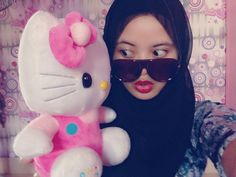 Hijab and hellokitty's doll