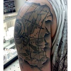 Black ink map with two compass tattoo on man side rib tattoos antique compass and map by emily at our mechanicsburg location tattoo tattoos gumiabroncs Images