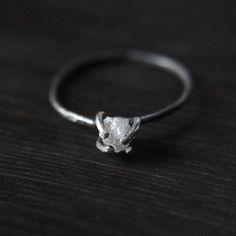 Rough diamond ring - I like the industrial setting, simple and different    Please use my link   http://fab.com/zhn2tb