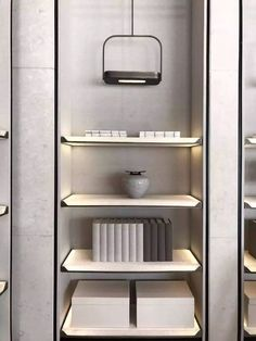 Minimalistic shelf with an indirect lighting concept - There is probably not that much more to ask for.Except one of HOLY TRINITY's innovative design lights, of course. Shelving Design, Storage Design, Shelf Design, Cabinet Design, Cabinet Shelving, Display Shelves, Retail Shelving, Cabinet Furniture, Furniture Design