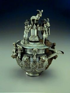 Pre Achaemenid silver vessel ornamented with figure of lion and winged ibex,Western Iran (800-600 BCE). Miho museum