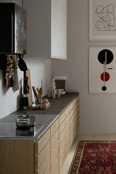 Scandinavian kitchen style - stainless steel worktop with hub cut out. Light wood cabinets. Worktop StalaTex - pattern Leaf.