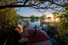 Sindabezi Island Lodge in Zambia is set on a secluded private island in the middle of the Zambezi, this is the only bush camp in the Victoria Falls region and a luxurious and really rather romantic option. Safari Holidays, Safari Adventure, Victoria Falls, African Safari, Home Staging, Luxury Travel, Lodges, Sunsets, Beautiful Places