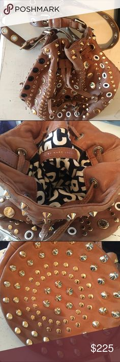 Marc by Marc Jacobs Bag w/ studs & grommets So cute, i love this bag. condition is only okay...leather shows definite signs of use, but perfect for concerts and studs/detailing mask the wear (can be worn cross body). as such not willing to sell unless im offered a certain quantity. vintage - insanely difficult to find. Bags Crossbody Bags