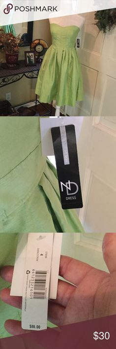"""New Directions Formal Dress NWT Spring Green. Tea-length. Taffeta-like Formal Dress. Pleated. Strapless. Back zipper. Inside boning. Inner lining 1 1/2"""" seam stitching loose. See picture. DOES NOT EFFECT OUTSIDE LOOK OR WEAR OF DRESS. New Directions Dresses Wedding"""