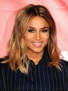 How to style mid-length hair like Ciara's modern lob hairstyle: center-parted waves | allure.com