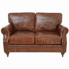 The crackled leather gives the Aran loveseat an authentic worn look that adds to its timeless charm. The traditional living room sofa has stud deta