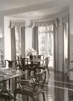 In the Lake Forest dining room of the Leslie Wheeler house, Frances Elkins installed these mustard-yellow curtains with white plaster valances in 1934.