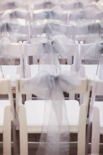 Ribbons on chairs for wedding ceremony.