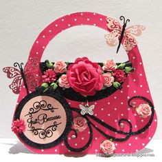 I love this handbag card with all the beautiful flowers, butterflies and black scroll detailing.