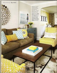 Brown sofa, neutral walls, brighter pillows.