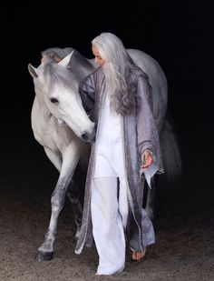 Jasmina Rossi with a graceful horse.