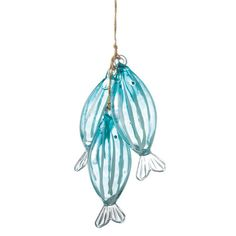 Bring a splash of undersea style to your holiday decor with this charming ornament, showcasing a trio of blue glass fish.   Produc...