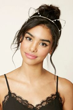 A metal headband featuring rhinestone-studded cat ear appliques.