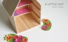 You could use this to make Fairy houses for a Fairy Garden - popsicle sticks + paper