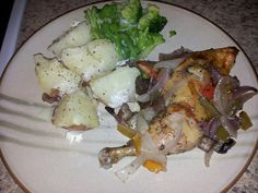 Baked chicken with red onion white onion and peppers with chopped red potatoes with broccoli