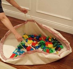 Play mat becomes storage bag. Love it. Must make one for the dang lincoln logs. And one for the little people. And one for the...