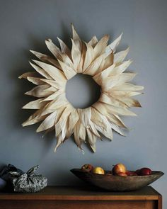 Corn-Husk Wreath, made with tamale wrappers; dunk in water, pin to wreath to dry, attach with glue gun