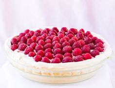 Showcase the first raspberries of spring with this luscious Raspberry Meringue Pie. A golden meringue crust is filled with lemon custard, then topped with sweetened berries folded into whipped cream. Naturally gluten free.