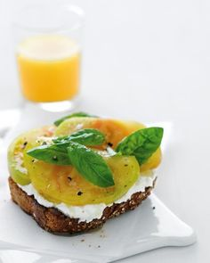 Ricotta and Tomato Toast - Spread fresh, creamy ricotta on a thick slice of whole-wheat toast and top with heirloom tomato, fresh basil leaves, and a small drizzle of olive oil for an easy, satisfying summer breakfast, afternoon snack, or appetizer.