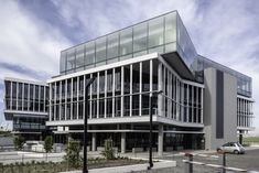 Sable Park comprises two four-storey buildings of and respectively with two levels of underground parking. The buildings are each split into two wings with a central core and full height atrium bringing light into the centre of the expansive floor plates. Building Facade, Commercial Design, Atrium, Architects, Centre, Buildings, Multi Story Building, Wings, Design Inspiration