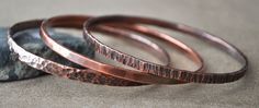 Handcrafted / Hand Forged Copper Bangle Bracelet Set of Three, Thick Hammered Bracelets, Heavy Gauge, Copper Bracelet Women by ChristinaSteward on Etsy https://www.etsy.com/listing/84551477/handcrafted-hand-forged-copper-bangle