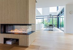 Image 6 of 15 from gallery of Villa S / N+P Architecture. Photograph by Andreas Mikkel Hansen Fireplace Surrounds, Fireplace Design, Gas Fireplace, Home Room Design, House Design, Villa, Internal Design, Traditional Fireplace, Wooden Slats