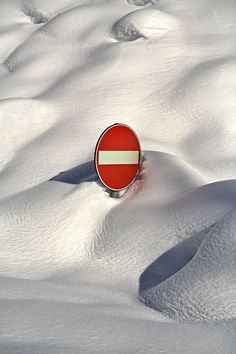 red street sign in heavy snow