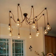 A county style loft idea, a ceiling light with naked Edison bulbs to add to the old fashioned look. Available at Anemos Lifestyle, India. We offer free shipping within the country