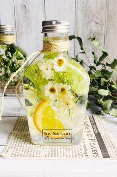 母の日のギフトにもぴったりの本物のフルーツが入った可愛らしいフルーツハーバリウム lemonです (フルーツはオレンジです)◎1枚めの画像 手前の リキ...