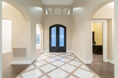 Spanish Transitional - Front Entry from the Inside.  Architectural Design: I PLAN, LLC  Builder: Starwood Custom Homes  #frontentry #foyer #customhomes #houseplans #architect #architecture #architecturaldesign #iplanllc #iplandesign #homes #luxuryhomes #azhomes #architectinmesa #architectinphoenix