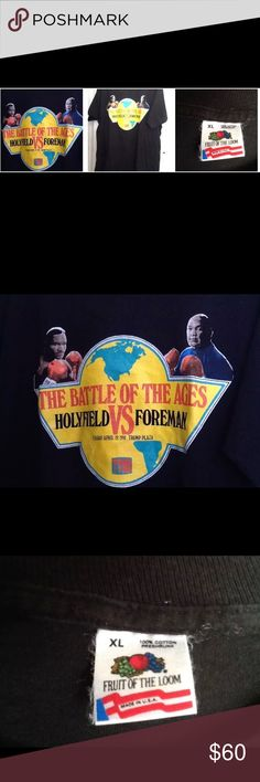Vintage t-shirt HOLYFIELD VS. FOREMAN Boxing 1991 Original authentic limited edition vintage promotional official broadcaster giveaway tee shirt. Holyfield vs. Foreman, Battle of the Ages, Trump Plaza, April 19, 1991, TVKO. Size adult men's extra large XL, black, Fruit of the Loom, made in the U.S.A. 100% cotton, preshrunk. Excellent vintage condition, a rare find! Fruit of the Loom Shirts Tees - Short Sleeve