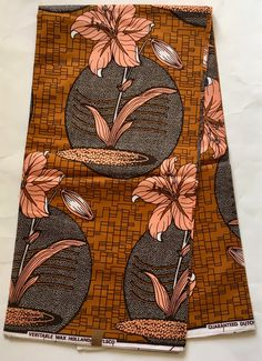 House of Mami Wata African Print Fabrics https://www.etsy.com/listing/537544946/african-print-fabric-ankara-brown-peach