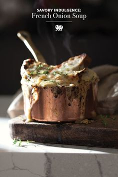 Soup's on! This French onion soup recipe from Cambria Style will warm you up on winter evenings and provide a filling dinner or lunch. [Featured Design: Brittanicca] #MyCambria #souprecipes #winterrecipes #frenchonionsoup