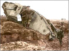 """Albert I King of the Belgians (left), with General Edmund Allenby inspecting a derelict Mark II tank, serial Nº 777' (named 'Charlie Chapin') of """"C"""" Battalion, 8 Company, C24, 2Lt P. Sailiard – attached to VI Corps, lost in the First Battle of the Scarpe, 9th April 1917, at Tilloy-les-Mofflaines, Pas-de-Calais.  (Ditched, photographed 17 May 1917, then set afire and destroyed by shell)  (Photo source - © IWM Q 3559)  (Colourised by Doug)"""