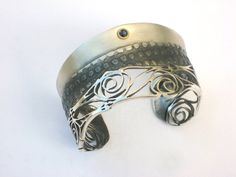 Handmade modern Art Nouveau inspired Bracelet Cuff.Sterling silver,22k gold and cyanite. Alex de Haro