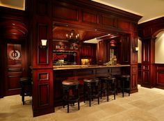 New construction entertainment room in Lake Worth, FL. The contractor is Wightman Construction, Inc  the designer is Patrick Johnson with East Shore Cabinetry LLC. StarMark Hanover door style in Cherry finished w/Chateau Brittany. More photos: https://www.facebook.com/WightmanConstruction/photos_stream#!/media/set/?set=a.385619834854169.91237.122256837857138=3   Before  after photos: http://wightmanconstruction.com/action/portfolio/perth-road-before-after/