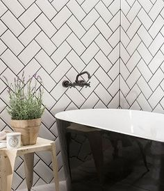 Bathroom wall tiles at Topps Tiles. Metro Tiles Bathroom, Bathroom Wall Panels, White Bathroom Tiles, Bathroom Floor Tiles, Bathroom Interior, Small Bathroom, Bathrooms, Bathroom Wallpaper, White Tiles Black Grout
