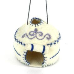 Yurt Felt Holiday Ornament - Silk Road Bazaar (O) Not your traditional holiday ornament, women in Kyrgyzstan made this ornament that represents the traditional home by hand from felt. With a loop for hanging, this piece measures 3 inches in diameter.